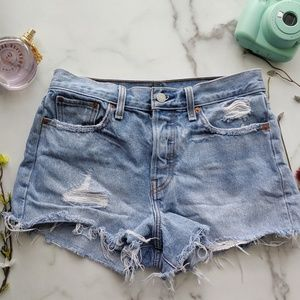 LEVI'S distressed light wash button fly shorts